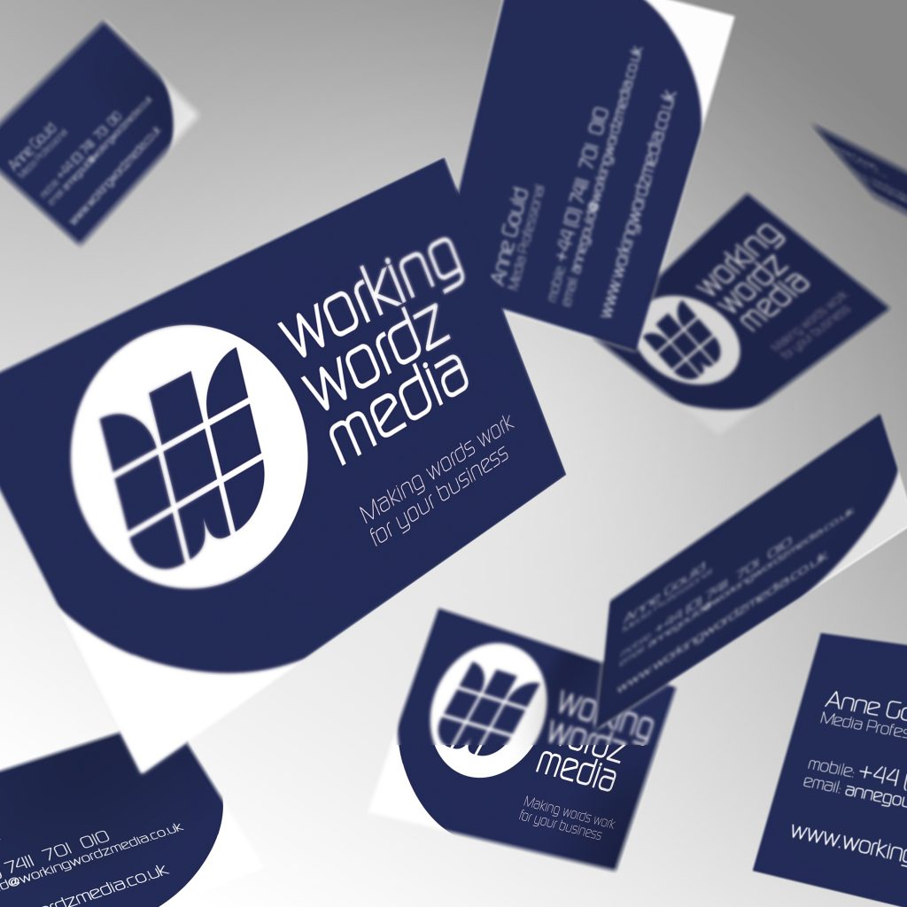 Working Wordz Media business cards showing front and back