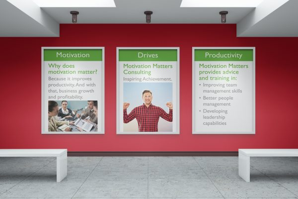 Three individual posters on a red wall