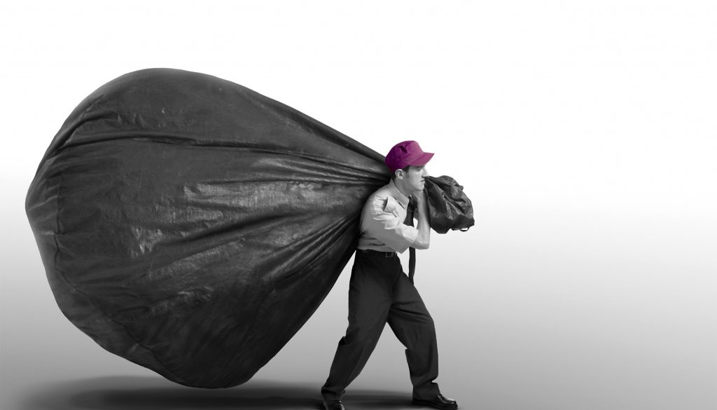 Mono image of a man with a large delivery bag