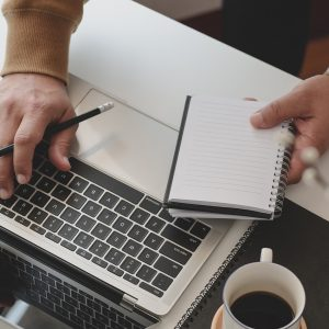 Specialist working on a MacBook
