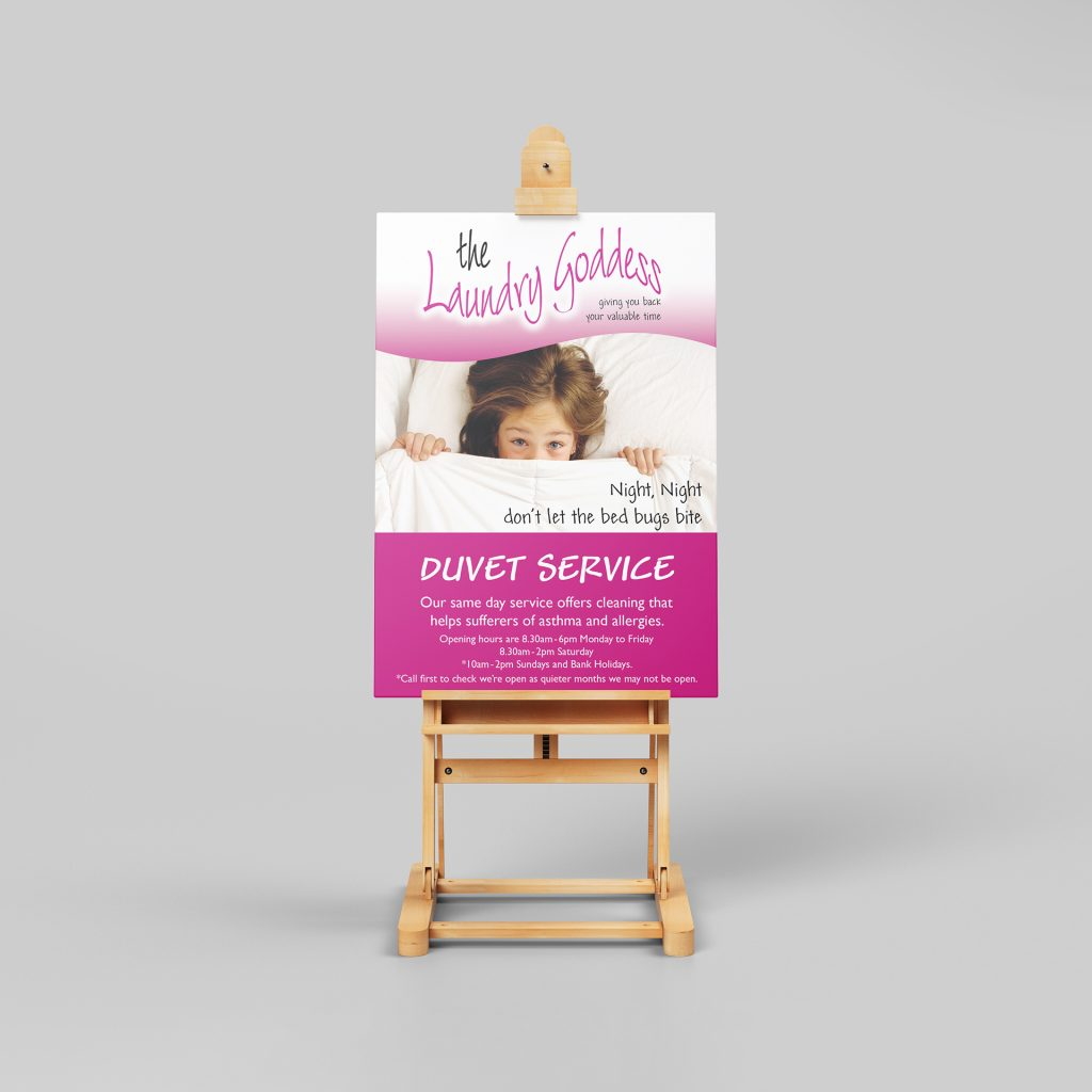 Laundry goddess duvet service poster on a stand