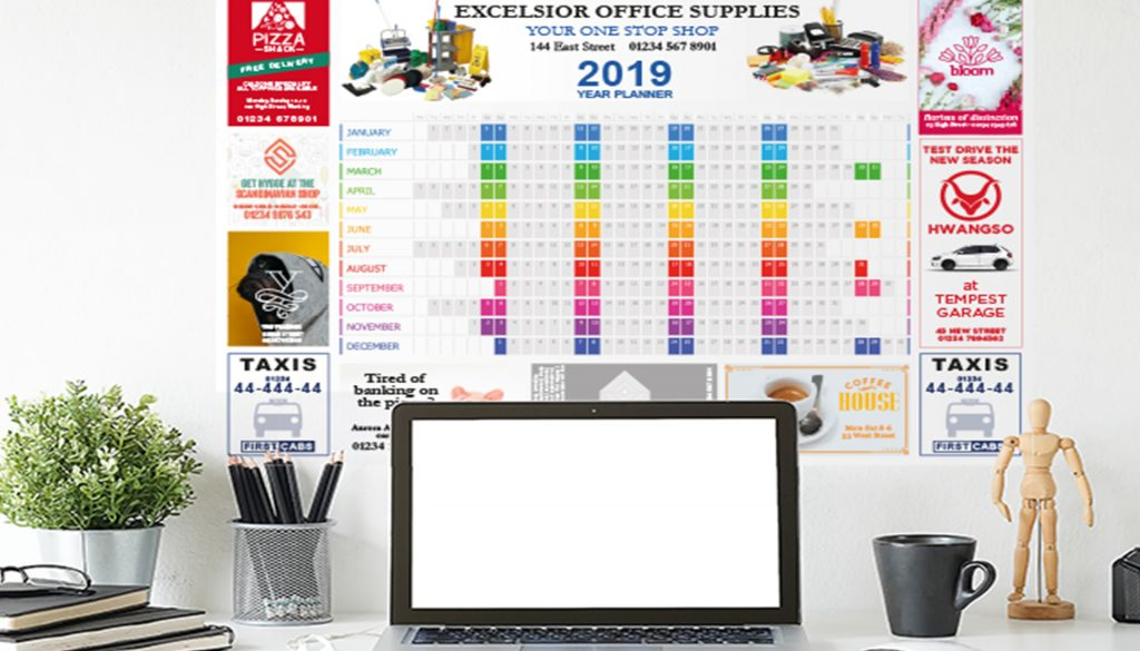 Wall planner above a desk
