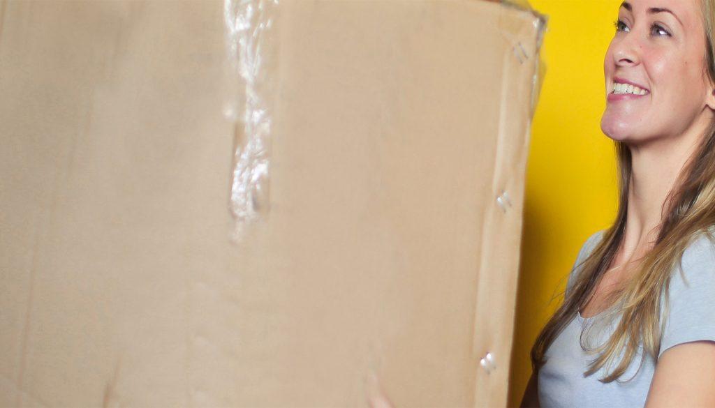 Female holding a cardboard box