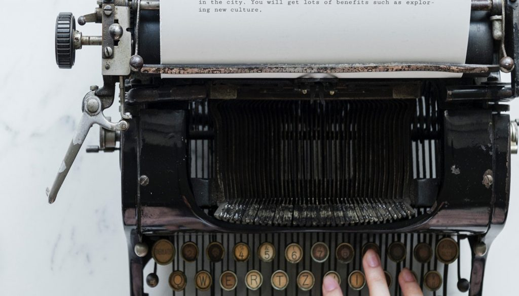 Quote being typed on a typewriter