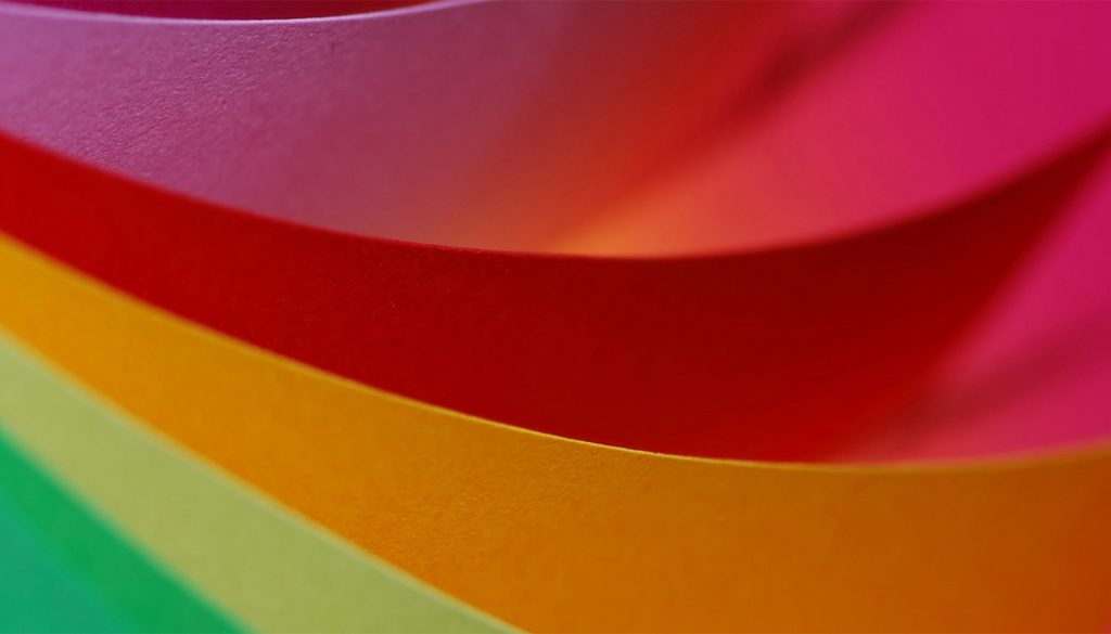 Green orange and red coloured paper